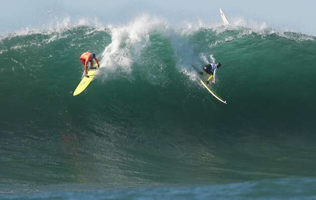 Mark Healey, left, and Nathan Fletcher drop in going opposite ways on a wave during the semi-finals at the Mavericks Invitational on Sunday, January 20, 2013. Photo: Mathew Sumner, Special To The Chronicle