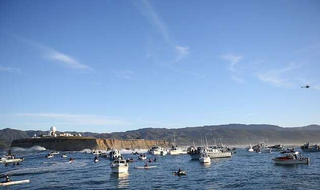 A flotilla of watercraft populate the waters off Pillar Point during the Mavericks Invitational on Sunday, January 20, 2013. Photo: Mathew Sumner, Special To The Chronicle