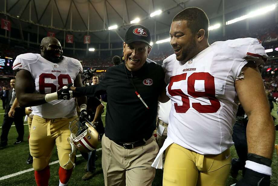 ATLANTA, GA - JANUARY 20:  (L-R) Leonard Davis #68 and head coach Jim Harbaugh and Jonathan Goodwin #59 of the San Francisco 49ers celebrate as they walk off of the field after they won 28-24 against the Atlanta Falcons in the NFC Championship game at the Georgia Dome on January 20, 2013 in Atlanta, Georgia.  (Photo by Streeter Lecka/Getty Images) Photo: Streeter Lecka, Getty Images