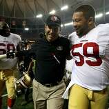 ATLANTA, GA - JANUARY 20:  (L-R) Leonard Davis #68 and head coach Jim Harbaugh and Jonathan Goodwin #59 of the San Francisco 49ers celebrate as they walk off of the field after they won 28-24 against the Atlanta Falcons in the NFC Championship game at the Georgia Dome on January 20, 2013 in Atlanta, Georgia.  (Photo by Streeter Lecka/Getty Images)