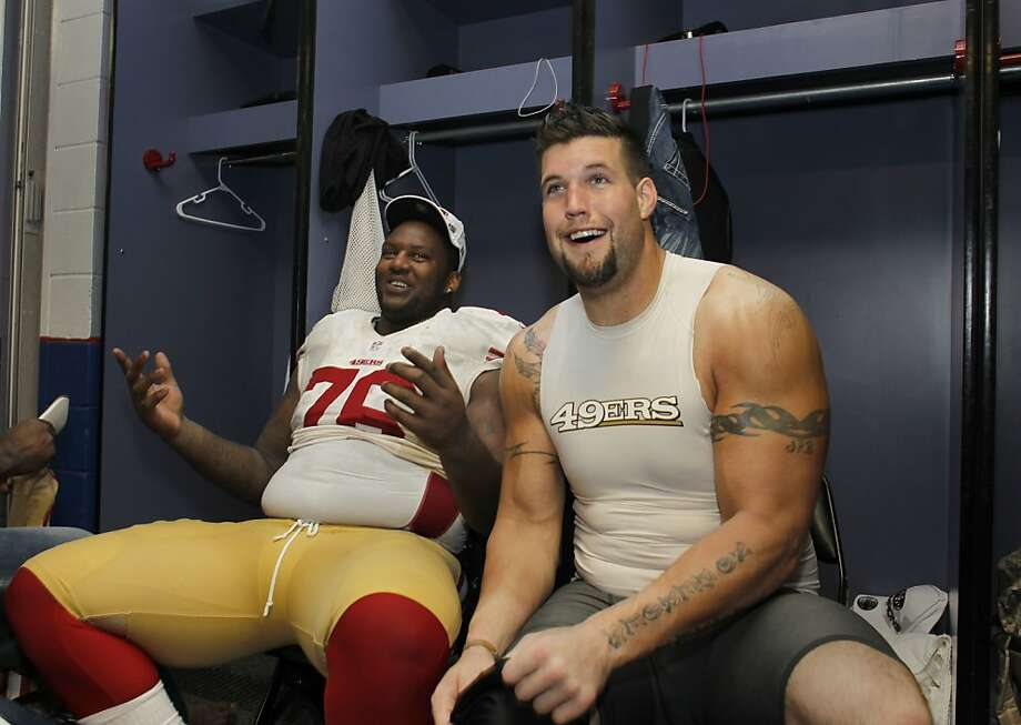 Alex Boone (right, with Anthony Davis) signed a four-year extension in late 2011 but is now holding out. Photo: Michael Macor, The Chronicle