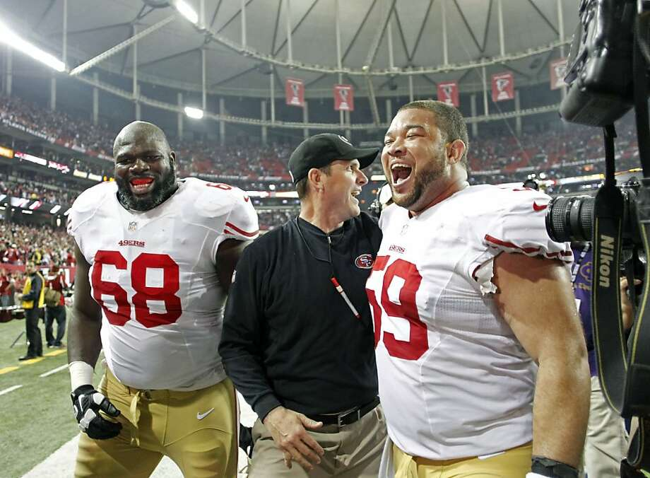 Jonathan Goodwin (right) celebrates the NFC title with Leonard Davis and coach Jim Harbaugh. Photo: Michael Macor, The Chronicle
