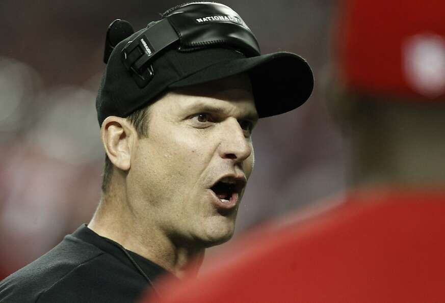 49ers head coach Jm Harbaugh talks with a referee in the fourth quarter, as the San Francisco 49ers