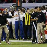Jim Harbaugh is held back by a referee while yelling after an instant replay call went against the 49ers in the fourth quarter. The San Francisco 49ers played the Atlanta Falcons in the NFC Championship Game in the Georgia Dome in Atlanta, Ga., on Sunday, January 20, 2013. The 49ers defeated the Falcons 28-24 and advancing to the Superbowl.