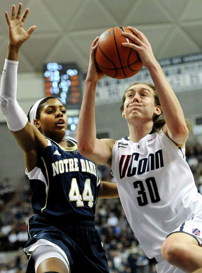 Connecticut's Breanna Stewart (30) drives to the basket while guarded by Notre Dame's Ariel Braker during the second half of an NCAA college basketball game in Storrs, Conn., Saturday, Jan. 5, 2013. Notre Dame won 73-72. (AP Photo/Jessica Hill) Photo: Jessica Hill, Associated Press / FR125654 AP