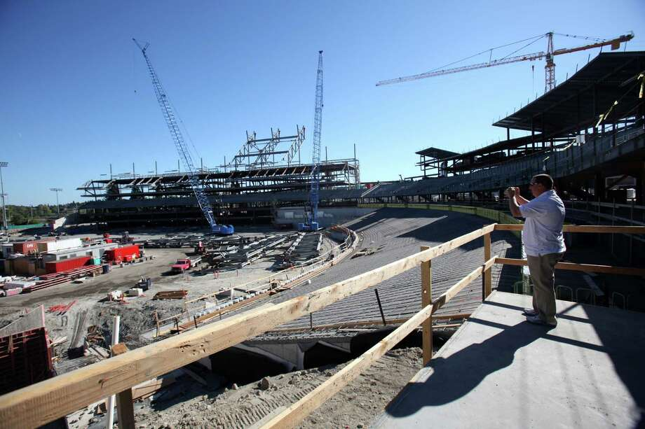 Radio host Dave Softy Mahler takes photos during a tour of the Husky Stadium construction site on Friday, August 24, 2012. Photo: JOSHUA TRUJILLO / SEATTLEPI.COM