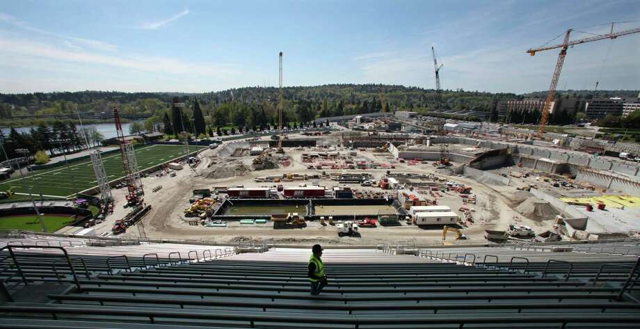 Progress on renovation of Husky Stadium is seen from the existing north bleachers looking south during a tour for media members Monday, April 23, 2012, in Seattle. Photo: AP