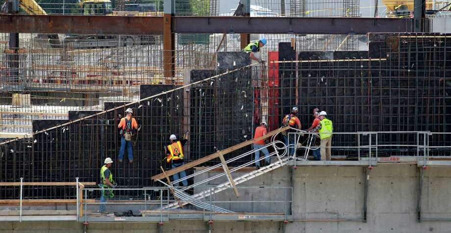 Workers prepare framing for concrete to support the west stands during renovation of the Husky Stadium on Monday, April 23, 2012, in Seattle. Photo: AP