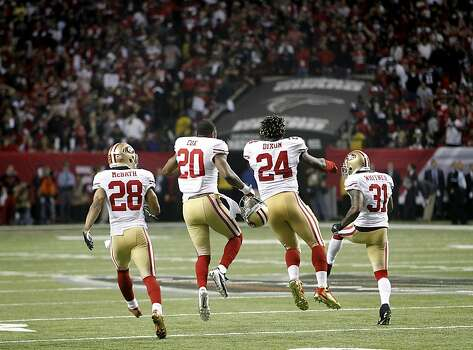 49ers Darcel McBath, (28) Perrish Cox, (20) , Anthony Dixon, (24) and Donte Whitner, (31) celebrate at the end of the game, as the San Francisco 49ers beat the Atlanta Falcons 28-24 to win the NFC Championship game on Sunday Jan. 20,  2013,  at the Georgia Dome in Atlanta Ga. Photo: Michael Macor, The Chronicle