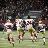 49ers Darcel McBath, (28) Perrish Cox, (20) , Anthony Dixon, (24) and Donte Whitner, (31) celebrate at the end of the game, as the San Francisco 49ers beat the Atlanta Falcons 28-24 to win the NFC Championship game on Sunday Jan. 20,  2013,  at the Georgia Dome in Atlanta Ga.