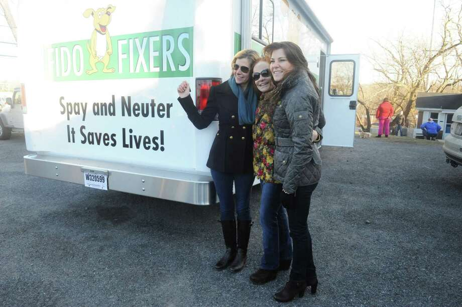 Lisa Wysocki, left, Suzanne Steinberg and Susan Maunis of Greenwich, their non- profit Fido Fixer Inc., took delivery of its new 26-foot vehicle Sunday that will be used as a mobile spay and neuter clinic. The vehicle arrived at the Harrison, N.Y., based Westchester Humane Society. It is one of the groups working with Fido Fixer. Photo: Helen Neafsey / Greenwich Time