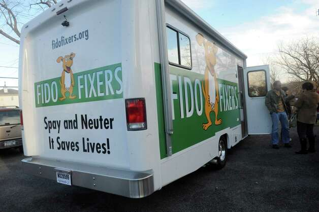 The Fido Fixer Inc. truck stands at the Westchester Humane Society in Harrison, N.Y., Sunday, Jan. 20. 2013.  Greenwich-based non profit Fido Fixer Inc., took delivery of its new 26-foot vehicle Sunday that will be used as a mobile spay and neuter clinic. The vehicle arrived at the Harrison, N.Y., based Westchester Humane Society. It is one of the groups working with Fido Fixer. Photo: Helen Neafsey / Greenwich Time