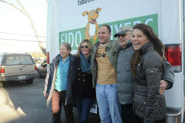 From left: Ruth Frumkin, of Pet Rescue, Lisa Wysocki, of Fido Fixes, Eric Lobel, of president of Westchester Humane Society, who had driven the Fido Fixes truck, John  Iannuzzi, volunteer, Susan Maounis, of Fido Fixes celebrate the Fido truck Sunday, Jan. 20, 2013. Greenwich-based non profit Fido Fixer Inc., took delivery of its new 26-foot vehicle Sunday that will be used as a mobile spay and neuter clinic. The vehicle arrived at the Harrison, N.Y., based Westchester Humane Society. It is one of the groups working with Fido Fixer. Photo: Helen Neafsey / Greenwich Time