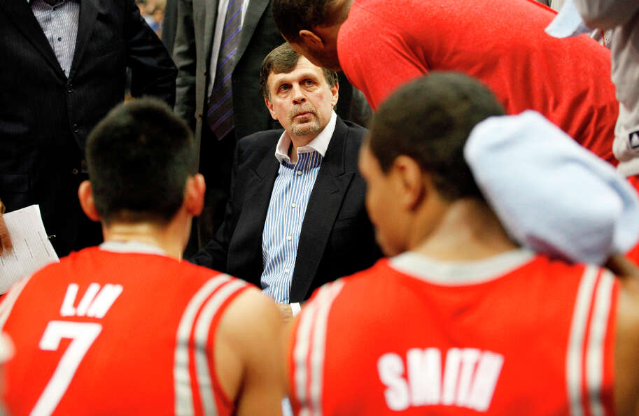 Rockets head coach Kevin McHale talks with his team during a timeout against the Timberwolves in the