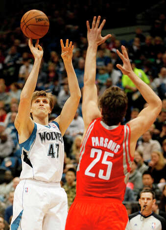 Timberwolves forward Andrei Kirilenko shoots over Chandler Parsons of the Rockets. Photo: Stacy Bengs