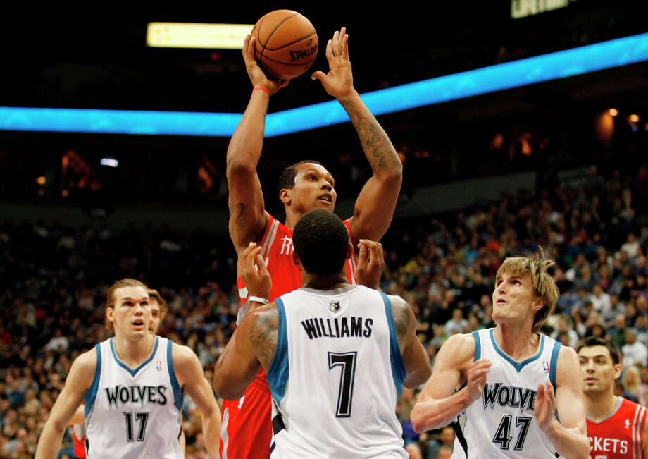 Rockets center Greg Smith shoots over Derrick Williams of the Timberwolves. Photo: Stacy Bengs