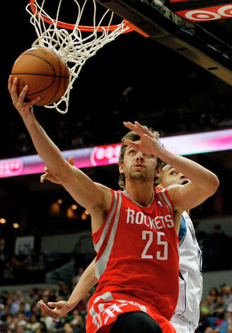 Rockets forward Chandler Parsons shoots at the basket against the Timberwolves. Photo: Stacy Bengs