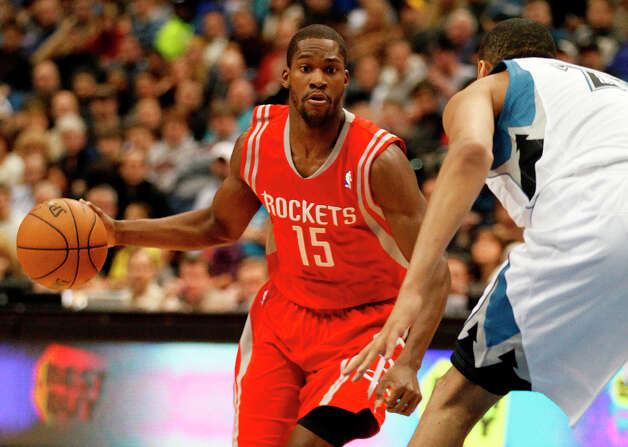 Rockets guard Toney Douglas examines the Timberwolves' defense before making a pass. Photo: Stacy Bengs