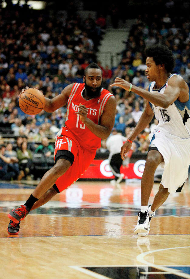 Rockets guard James Harden drives the ball past Mickael Gelabale of the Timberwolves. Photo: Stacy Bengs