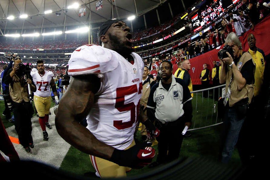 49ers linebacker Patrick Willis celebrates after his team beat the Falcons to clinch a Super Bowl be