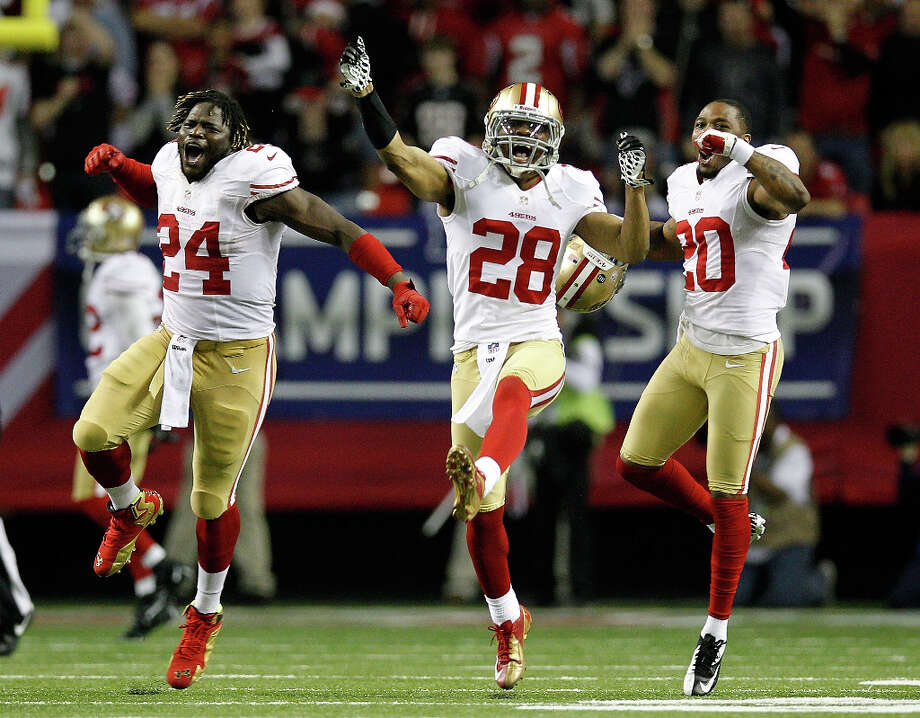49ers defensive backs Anthony Dixon, Darcel McBath and Perrish Cox react after stopping the Falcons on fourth-and-goal in the fourth quarter. Photo: Chris Graythen / 2013 Getty Images