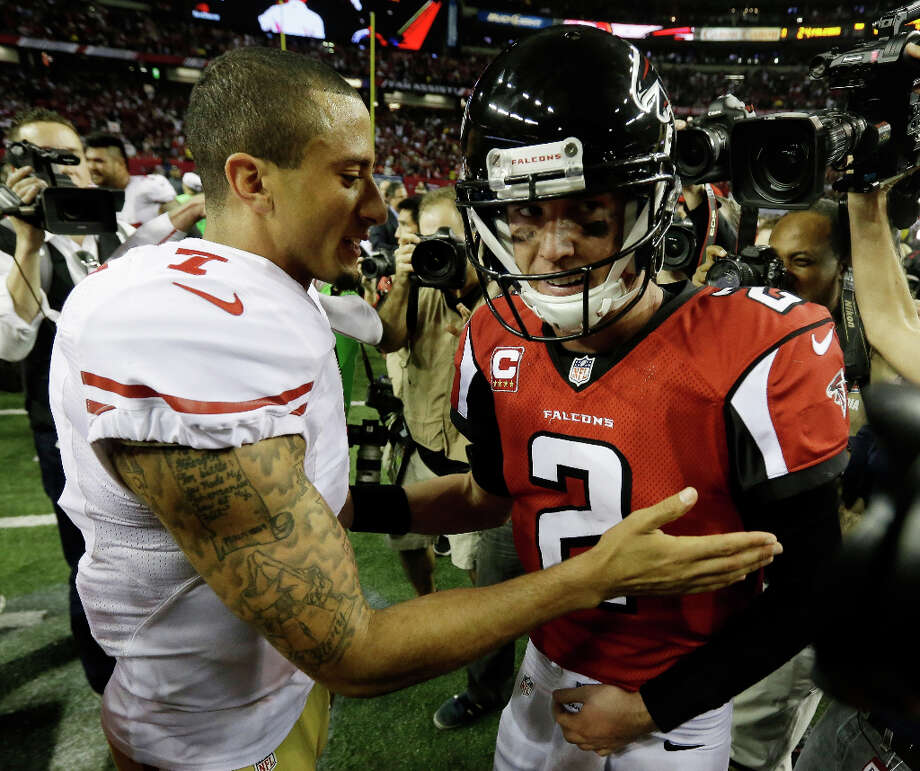 49ers quarterback Colin Kaepernick speaks with Falcons quarterback Matt Ryan after the game. Photo: Dave Martin