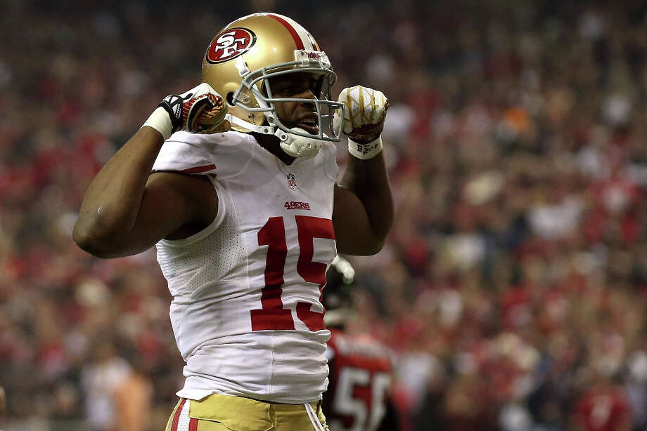 49ers receiver Michael Crabtree celebrates after hauling in a 33-yard catch in the fourth quarter. Photo: Streeter Lecka / 2013 Getty Images