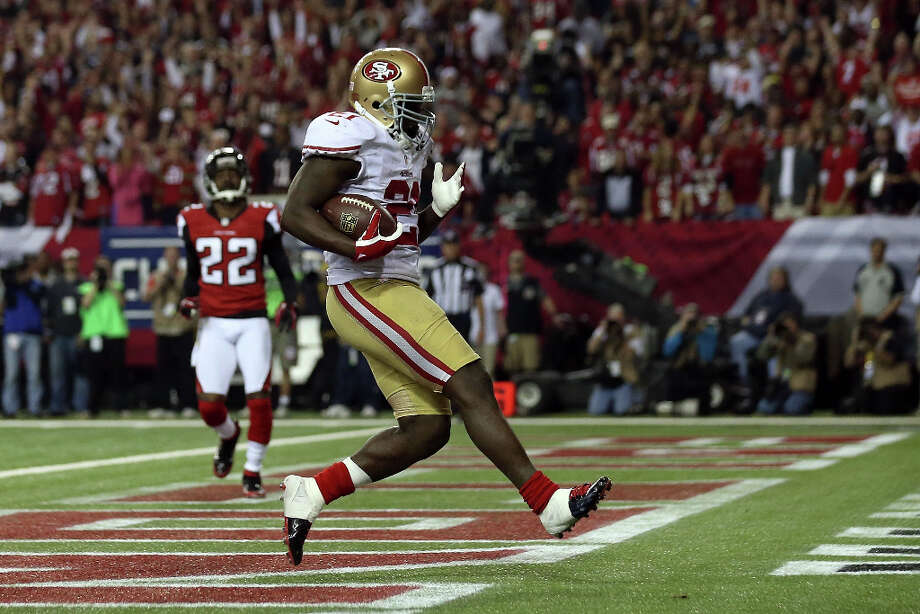 49ers running back Frank Gore celebrates after scoring a touchdown in the fourth quarter. Photo: Streeter Lecka / 2013 Getty Images