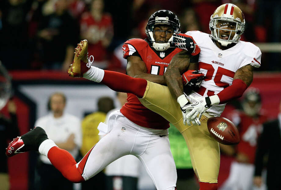 49ers cornerback Tarell Brown breaks up a pass intended for Falcons receiver. Julio Jones Photo: Kevin C. Cox / 2013 Getty Images