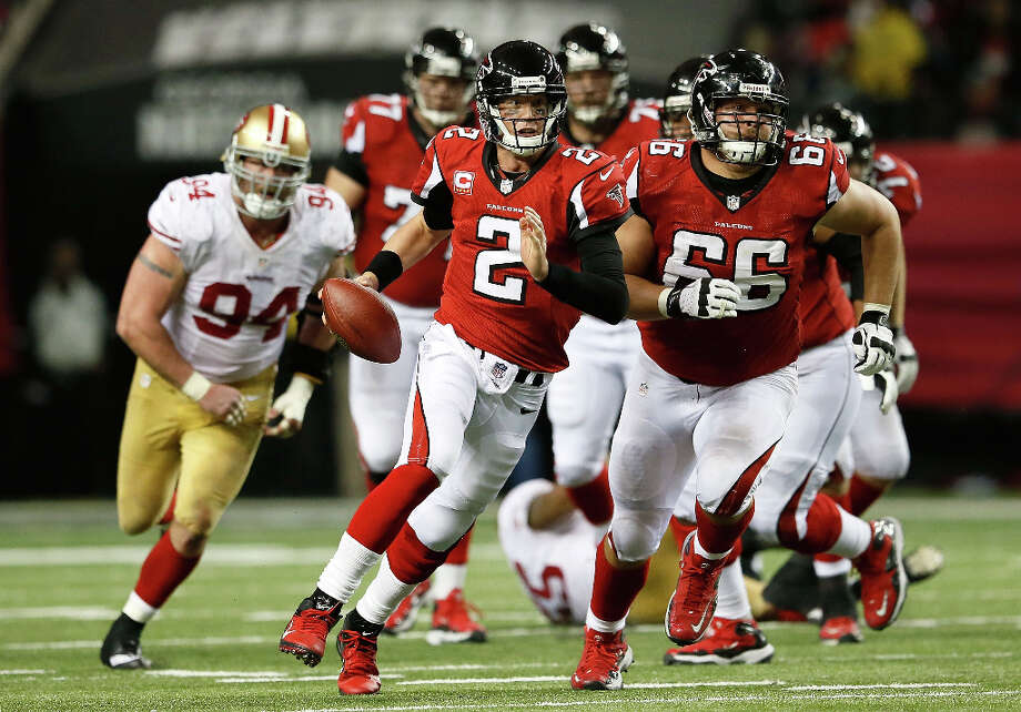 Falcons quarterback Matt Ryan runs against the 49ers defense. Photo: Kevin C. Cox / 2013 Getty Images