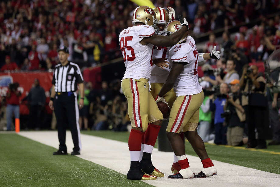 49ers tight end Vernon Davis, quarterback Colin Kaepernick and Frank Gore celebrate Gore's touchdown in the fourth quarter. Photo: Streeter Lecka / 2013 Getty Images