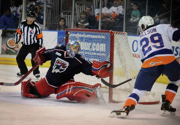 Springfield goalie Paul Dainton makes the save on a shot by Sound Tiger Brock Nelson in the first period of their AHL matchup at the Webster Bank Arena in Bridgeport on Sunday, January 20, 2013. Photo: Brian A. Pounds