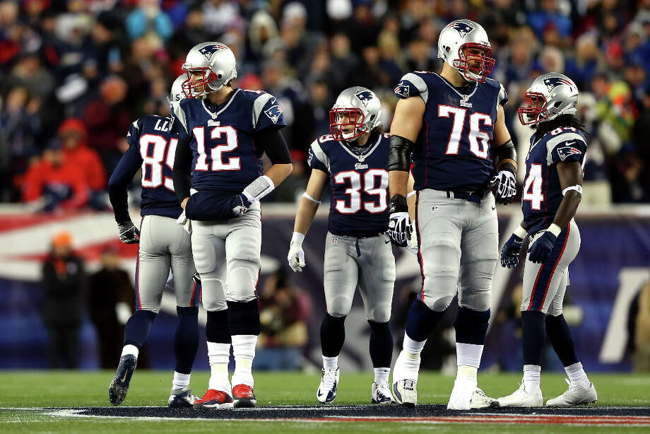 Tom Brady, Danny Woodhead, and Sebastian Vollmer look on against the Ravens. Photo: Elsa, Getty Images / 2013 Getty Images