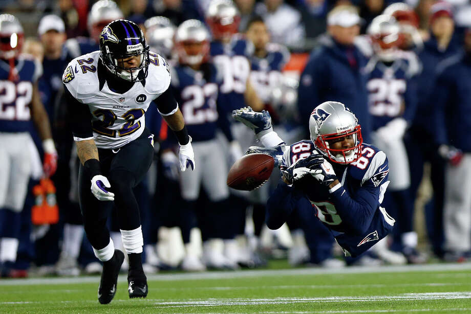 Brandon Lloyd #85 of the Patriots misses a catch against the Ravens. Photo: Jared Wickerham, Getty Images / 2013 Getty Images