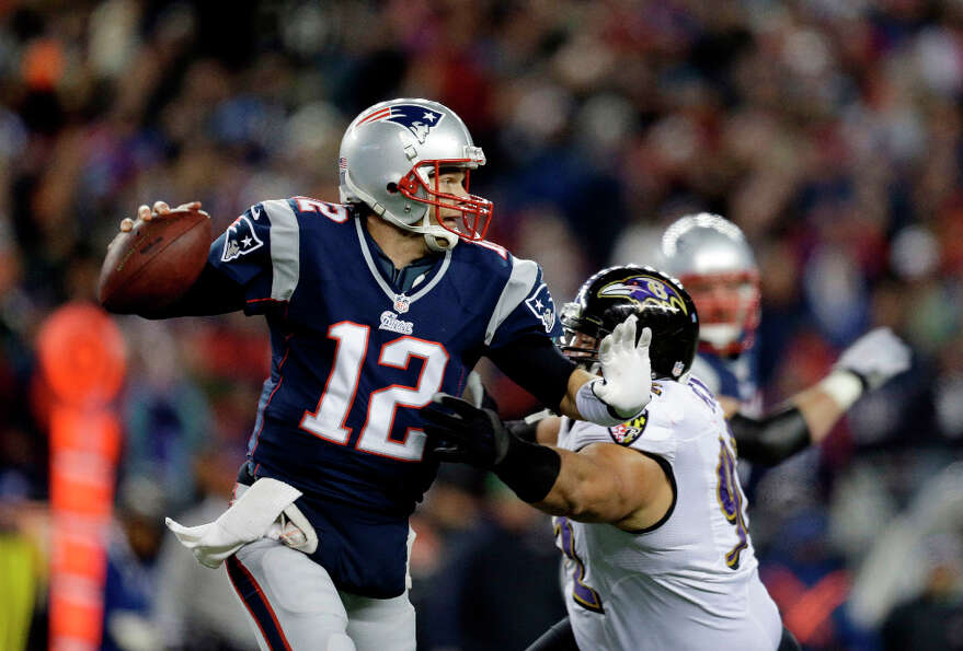 Ravens defensive end Haloti Ngata (92) chases Patriots quarterback Tom Brady.