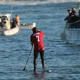 A stand up paddle boarder sports a Colin Kaepernick jersey at the Mavericks Invitational on Sunday, January 20, 2013.