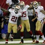 Frank Gore (left), Vernon Davis and Colin Kaepernick - three offensive architects of the victory - celebrate Gore's go-ahead score in the fourth quarter.