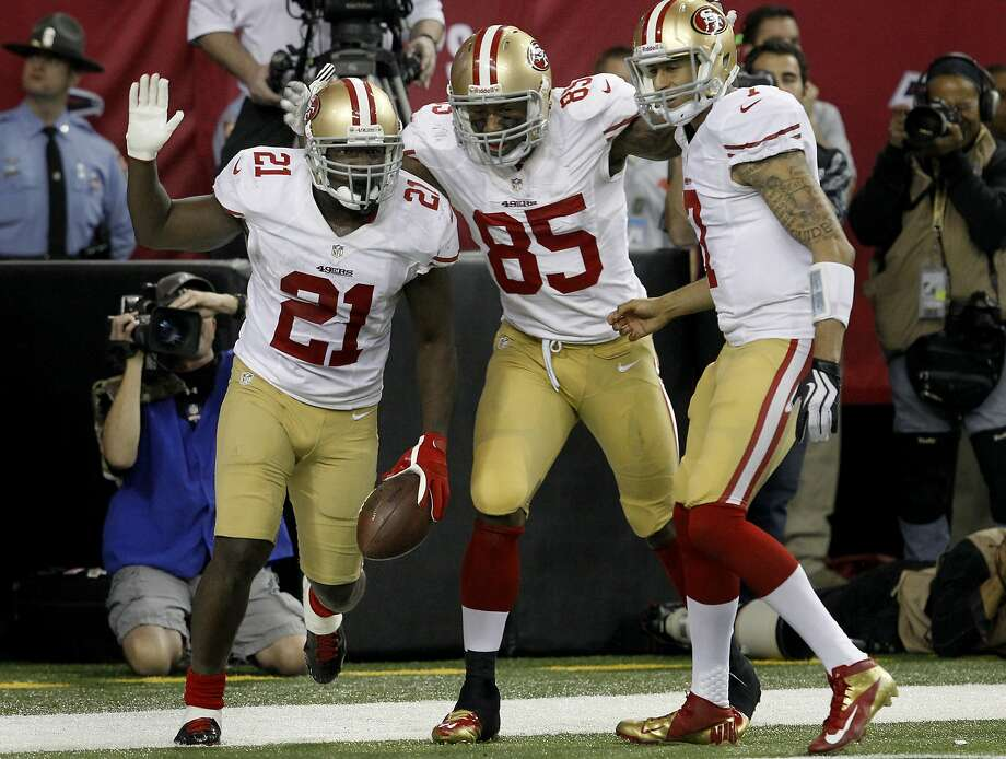 Frank Gore, Vernon Davis and Colin Kaepernick (l-r) celebrated Gore's game winning touchdown. The San Francisco 49ers beat the Atlanta Falcons 28-24 to win the NFC title and advance to the Super Bowl Sunday January 20, 2013. Photo: Brant Ward, The Chronicle