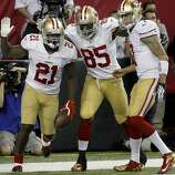 Frank Gore, Vernon Davis and Colin Kaepernick (l-r) celebrated Gore's game winning touchdown. The San Francisco 49ers beat the Atlanta Falcons 28-24 to win the NFC title and advance to the Super Bowl Sunday January 20, 2013.
