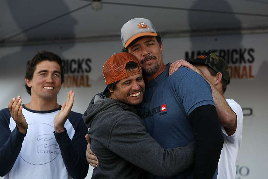 Mavericks Surf Competition winner, Peter Mel, is congratulated by fellow finalist, Alex Martins, during the awards ceremony on January 20, 2013 in Half Moon Bay, Calif. Photo: Sean Havey, The Chronicle