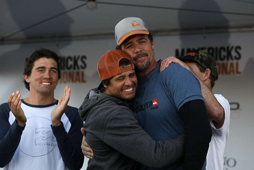 Mavericks Surf Competition winner, Peter Mel, is congratulated by fellow finalist, Alex Martins, dur
