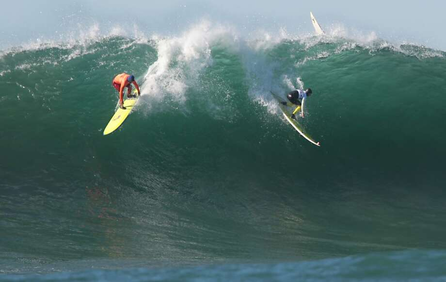 Mark Healey, right, and Nathan Fletcher drop in going opposite ways on a wave during the semi-finals at the Mavericks Invitational on Sunday, January 20, 2013. Photo: Mathew Sumner, Special To The Chronicle