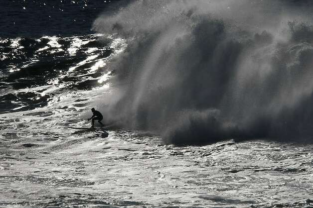 Peter Mel drops in on a wave during the final heat of the Mavericks Surf Competition on January 20, 2013 in Half Moon Bay, Calif. Mel went on to win the contest. Photo: Sean Havey, The Chronicle