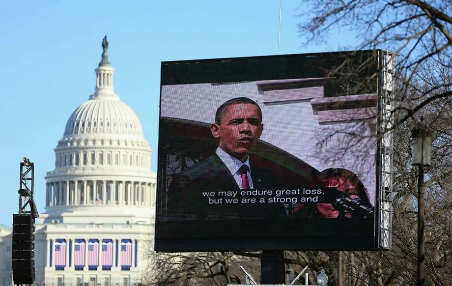 WASHINGTON, DC - JANUARY 20:  U.S. President Barack Obama is displayed on a jumbotron setup on the National Mall for the Inauguration ceremony on January 20, 2013 in Washington, DC.  The U.S. capital is preparing for the second inauguration of U.S. President Barack Obama, which will take place on January 21. Photo: Joe Raedle, Getty Images / 2013 Getty Images