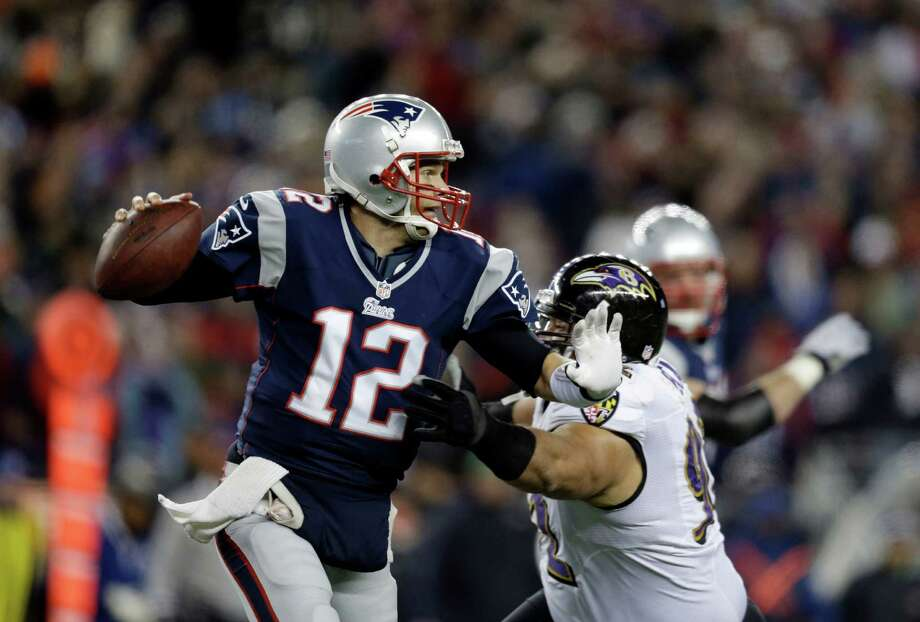 Baltimore Ravens defensive end Haloti Ngata (92) chases New England Patriots quarterback Tom Brady (12) during the first half of the NFL football AFC Championship football game in Foxborough, Mass., Sunday, Jan. 20, 2013. (AP Photo/Steven Senne) Photo: Steven Senne, Associated Press / AP