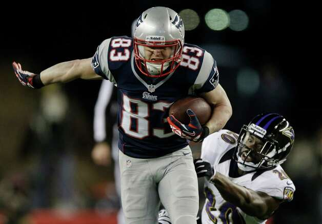 New England Patriots wide receiver Wes Welker (83) runs out of the tackle of Baltimore Ravens free safety Ed Reed (20) during the first half of the NFL football AFC Championship football game in Foxborough, Mass., Sunday, Jan. 20, 2013. (AP Photo/Matt Slocum) Photo: Matt Slocum, Associated Press / AP