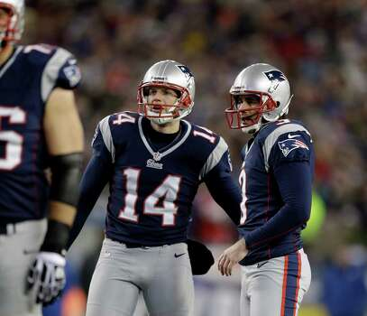 New England Patriots holder Zoltan Mesko (14) congratulates kicker Stephen Gostkowski, right, on his 25-yard field goal against the Baltimore Ravens during the first half of the NFL football AFC Championship football game in Foxborough, Mass., Sunday, Jan. 20, 2013. (AP Photo/Steven Senne) Photo: Steven Senne, Associated Press / AP