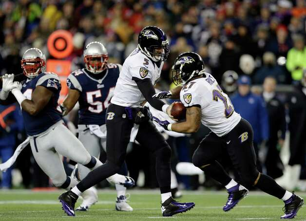 Baltimore Ravens quarterback Joe Flacco (5) hands off to running back Ray Rice (27) during the first half of the NFL football AFC Championship football game against the New England Patriots in Foxborough, Mass., Sunday, Jan. 20, 2013. (AP Photo/Elise Amendola) Photo: Elise Amendola, Associated Press / AP