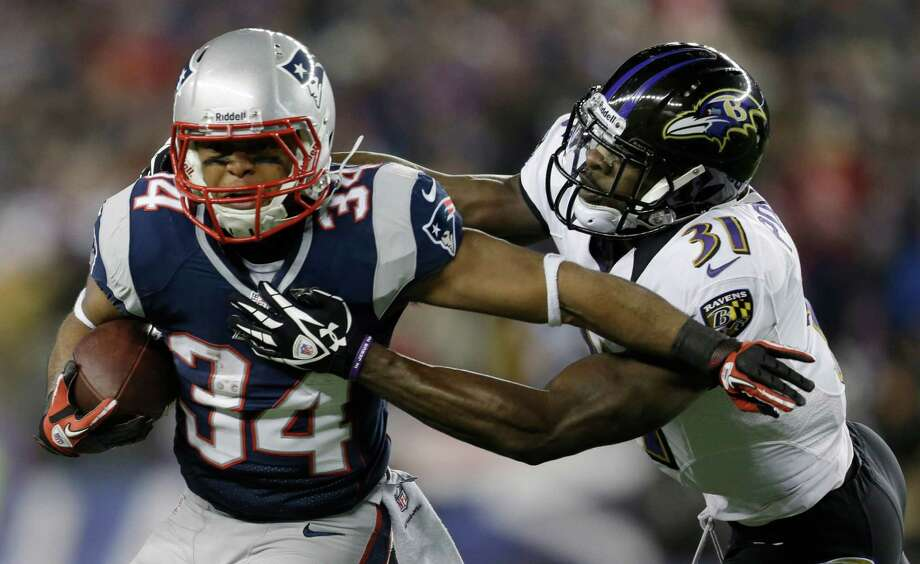 New England Patriots running back Shane Vereen, left, is tackled by Baltimore Ravens strong safety Bernard Pollard (31) during the first half of the NFL football AFC Championship football game in Foxborough, Mass., Sunday, Jan. 20, 2013. (AP Photo/Steven Senne) Photo: Steven Senne, Associated Press / AP