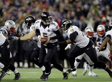 Baltimore Ravens quarterback Joe Flacco (5) looks to make a handoff during the first half of the NFL football AFC Championship football game against the New England Patriots in Foxborough, Mass., Sunday, Jan. 20, 2013. (AP Photo/Elise Amendola) Photo: Elise Amendola, Associated Press / AP